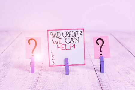 Conceptual hand writing showing Bad Credit Question We Can Help. Concept meaning offering help after going for loan then rejected Crumbling sheet with paper clips placed on the wooden table Stok Fotoğraf