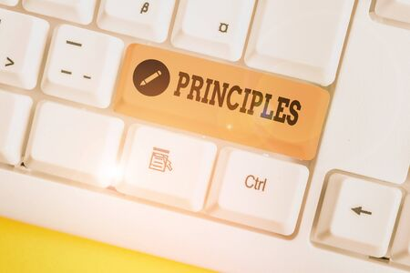 Text sign showing Principles. Business photo showcasing fundamental truth that serves as the base for a system of belief White pc keyboard with empty note paper above white background key copy space Stock fotó