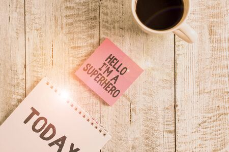 Word writing text Hello I M A Superhero. Business photo showcasing Believing in yourself Selfconfidence Introduction Stationary placed next to a cup of black coffee above the wooden table