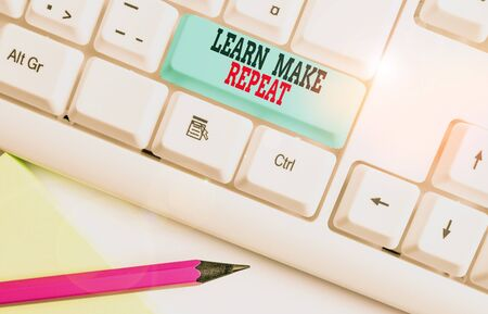 Text sign showing Learn Make Repeat. Business photo showcasing Once you do it will be easy fast learner fix mistakes White pc keyboard with empty note paper above white background key copy space