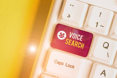 Text sign showing Voice Search. Business photo text allows the user to use a voice comanalysisd to search the Internet White pc keyboard with empty note paper above white background key copy space