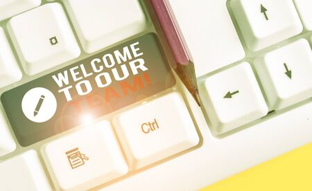 Conceptual hand writing showing Welcome To Our Team. Concept meaning introducing another demonstrating to your team mates White pc keyboard with note paper above the white background