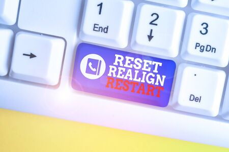 Writing note showing Reset Realign Restart. Business concept for Life audit will help you put things in perspectives White pc keyboard with note paper above the white background Stock Photo