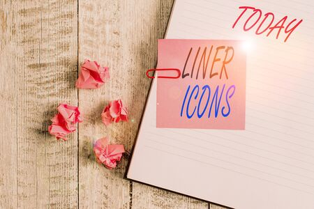 Writing note showing Liner Icons. Business concept for use to improve visual interest and grab the user s is attention Notebook stationary placed above classic wooden backdrop