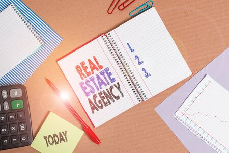 Handwriting text Real Estate Agency. Conceptual photo Business Entity Arrange Sell Rent Lease Manage Properties Striped paperboard notebook cardboard office study supplies chart paper