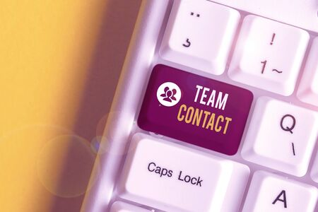 Text sign showing Team Contact. Business photo text The interaction of the individuals on a team or group White pc keyboard with empty note paper above white background key copy space