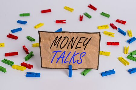 Handwriting text writing Money Talks. Conceptual photo the wealth gives power and influence to those who possess it Colored clothespin papers empty reminder white floor background office