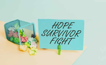 Writing note showing Hope Survivor Fight. Business concept for stand against your illness be fighter stick to dreams Trash bin crumpled paper clothespin reminder office supplies Stockfoto