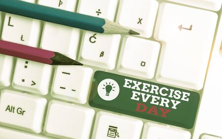 Text sign showing Exercise Every Day. Business photo showcasing move body energetically in order to get fit and healthy White pc keyboard with empty note paper above white background key copy space