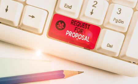 Writing note showing Request For Proposal. Business concept for document contains bidding process by agency or company White pc keyboard with note paper above the white background Stok Fotoğraf