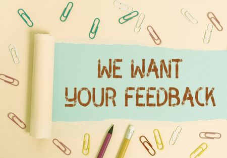 Writing note showing We Want Your Feedback. Business concept for to Improve Perforanalysisce or Product Timely Reaction Stationary and torn cardboard placed above plain pastel table backdrop