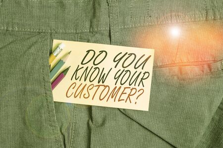 Writing note showing Do You Know Your Customer Question. Business concept for service identify clients with relevant information Writing equipment and yellow note paper inside pocket of man trousers