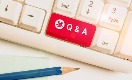 Writing note showing Q And A. Business concept for a period of time or an occasion when someone answers questions White pc keyboard with note paper above the white background