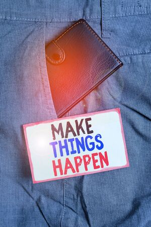 Conceptual hand writing showing Make Things Happen. Concept meaning Exert Effort to Achieve and Fulfill something Go and Act Small wallet inside trouser front pocket near notation paper Фото со стока