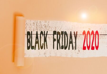 Writing note showing Black Friday 2020. Business concept for day following Thanksgiving Discounts Shopping day Cardboard which is torn placed above a wooden classic table