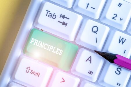 Handwriting text Principles. Conceptual photo fundamental truth that serves as the base for a system of belief White pc keyboard with empty note paper above white background key copy space