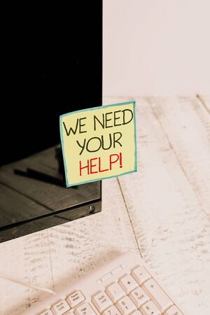 Handwriting text We Need Your Help. Conceptual photo asking someone to stand with you against difficulty Notation paper taped to black computer monitor screen near white keyboard