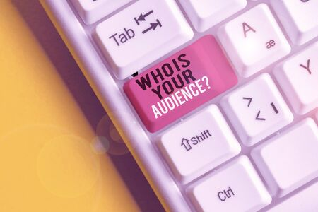 Text sign showing Who Is Your Audience Question. Business photo text who is watching or listening to it White pc keyboard with empty note paper above white background key copy space Фото со стока