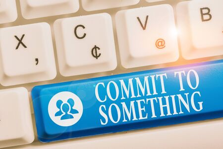 Word writing text Commit To Something. Business photo showcasing To Live a Life of Purpose with Pride Honor a Promise White pc keyboard with empty note paper above white background key copy space Stock fotó