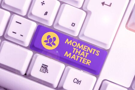 Handwriting text writing Moments That Matter. Conceptual photo Meaningful positive happy memorable important times White pc keyboard with empty note paper above white background key copy space