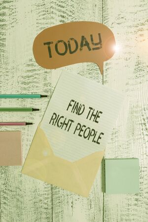Writing note showing Find The Right People. Business concept for look for a Competent demonstrating Hire appropriate Staff Envelop speech bubble paper sheet ballpoints notepads wooden background Reklamní fotografie