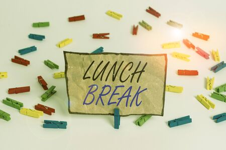 Handwriting text writing Lunch Break. Conceptual photo time when a demonstrating stops working or studying to have lunch Colored clothespin papers empty reminder white floor background office Stok Fotoğraf
