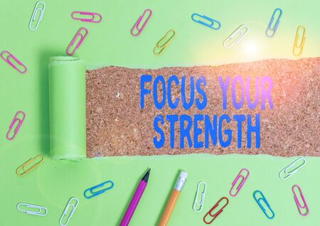 Word writing text Focus Your Strength. Business photo showcasing Improve skills work on weakness points think more Stationary and torn cardboard placed above a wooden classic table backdrop