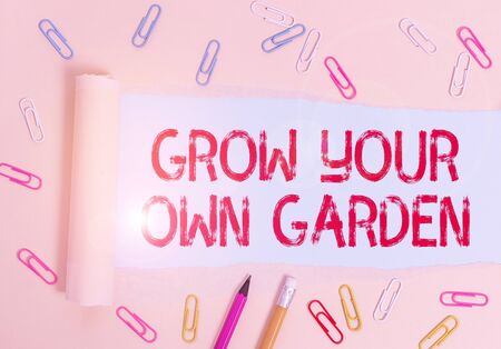 Writing note showing Grow Your Own Garden. Business concept for Organic Gardening collect demonstratingal vegetables fruits Stationary and torn cardboard placed above plain pastel table backdrop