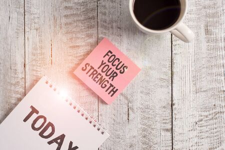 Word writing text Focus Your Strength. Business photo showcasing Improve skills work on weakness points think more Stationary placed next to a cup of black coffee above the wooden table Фото со стока