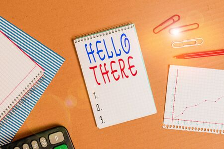 Handwriting text writing Hello There. Conceptual photo a way to get someone s is attention more strongly upon greeting Striped paperboard notebook cardboard office study supplies chart paper