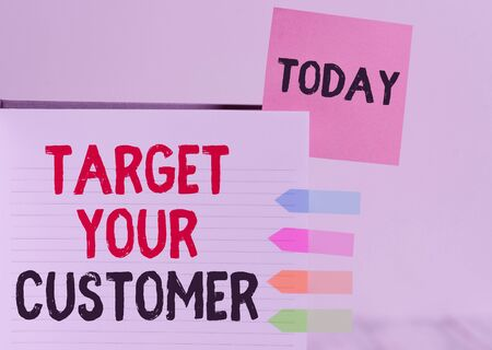 Word writing text Target Your Customer. Business photo showcasing Tailor Marketing Pitch Defining Potential Consumers Hard cover note book sticky note arrow banners inserted clear background