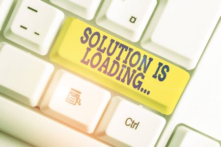 Text sign showing Solution Is Loading. Business photo text thinking of way to solve big problems Diagnoses White pc keyboard with empty note paper above white background key copy space