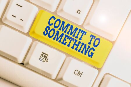 Text sign showing Commit To Something. Business photo text To Live a Life of Purpose with Pride Honor a Promise White pc keyboard with empty note paper above white background key copy space