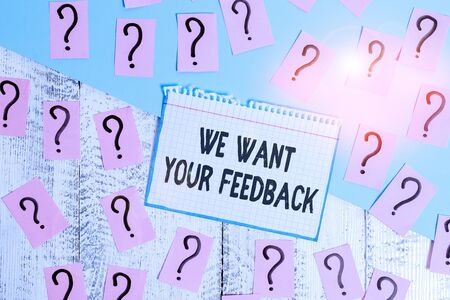Writing note showing We Want Your Feedback. Business concept for to Improve Perforanalysisce or Product Timely Reaction Scribbled and crumbling papers with thick cardboard above wooden table
