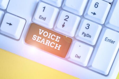 Text sign showing Voice Search. Business photo showcasing allows the user to use a voice comanalysisd to search the Internet White pc keyboard with empty note paper above white background key copy space