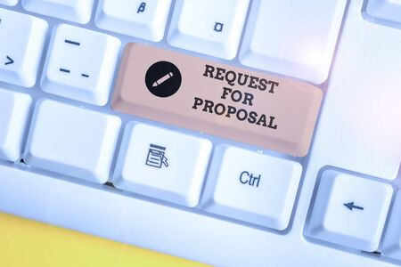 Text sign showing Request For Proposal. Business photo showcasing document contains bidding process by agency or company White pc keyboard with empty note paper above white background key copy space Stok Fotoğraf