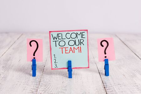 Conceptual hand writing showing Welcome To Our Team. Concept meaning introducing another demonstrating to your team mates Crumbling sheet with paper clips placed on the wooden table