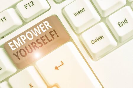 Text sign showing Empower Yourself. Business photo showcasing taking control of our life setting goals and making choices White pc keyboard with empty note paper above white background key copy space Reklamní fotografie
