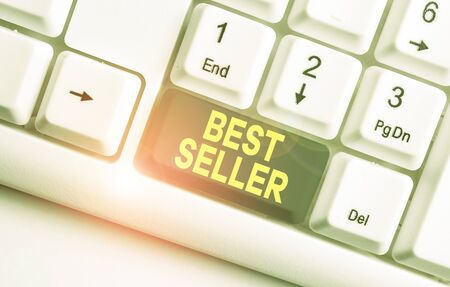 Writing note showing Best Seller. Business concept for new book or other product that has sold a great number of copies White pc keyboard with note paper above the white background