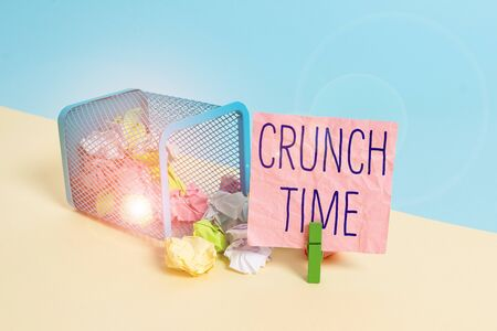 Conceptual hand writing showing Crunch Time. Concept meaning period when pressure to succeed is great often undertaking end Trash bin crumpled paper clothespin reminder office supplies Фото со стока