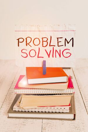 Conceptual hand writing showing Problem Solving. Concept meaning process of finding solutions to difficult or complex issues pile stacked books notebook pin color reminder white wooden