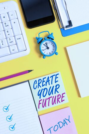 Writing note showing Create Your Future. Business concept for Set Target and Career goals Plan ahead Reach out White paper with copy space with paper clips clock and pc keyboard