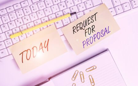 Conceptual hand writing showing Request For Proposal. Concept meaning document contains bidding process by agency or company Empty orange square papers by the pc keyboard with copy space