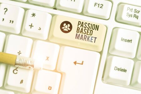 Conceptual hand writing showing Passion Based Market. Concept meaning Emotional Sales Channel a Personalize centric Strategy White pc keyboard with note paper above the white background Archivio Fotografico
