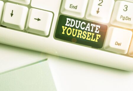 Handwriting text Educate Yourself. Conceptual photo prepare oneself or someone in a particular area or subject White pc keyboard with empty note paper above white background key copy space Reklamní fotografie
