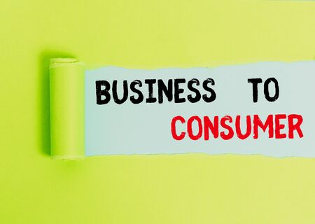 Text sign showing Business To Consumer. Business photo text Direct Transaction between a Company and end users Cardboard which is torn in the middle placed above a plain table backdrop 스톡 콘텐츠