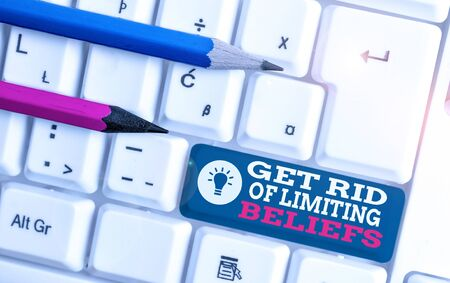 Text sign showing Get Rid Of Limiting Beliefs. Business photo showcasing remove negative beliefs and think positively White pc keyboard with empty note paper above white background key copy space