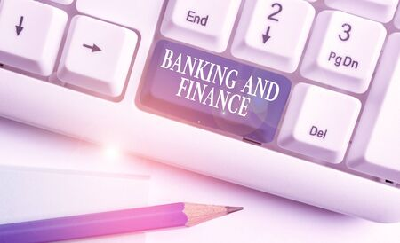 Conceptual hand writing showing Banking And Finance. Concept meaning Accounting and entities stocks Money interests White pc keyboard with note paper above the white background
