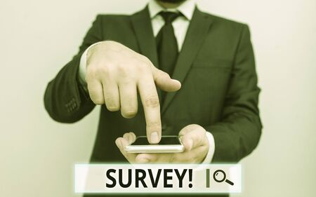 Text sign showing Survey. Business photo text research method used for collecting data from a predefined group Male human wear formal work suit hold smart hi tech smartphone use one hand