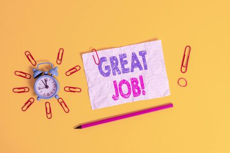 Handwriting text Great Job. Conceptual photo sed for telling someone that they have done something well Metal alarm clock clips crushed sheet pencil rubber band colored background Banco de Imagens